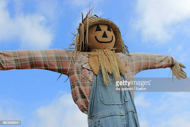 Low Angle View Scarecrow Against Cloudy Sky