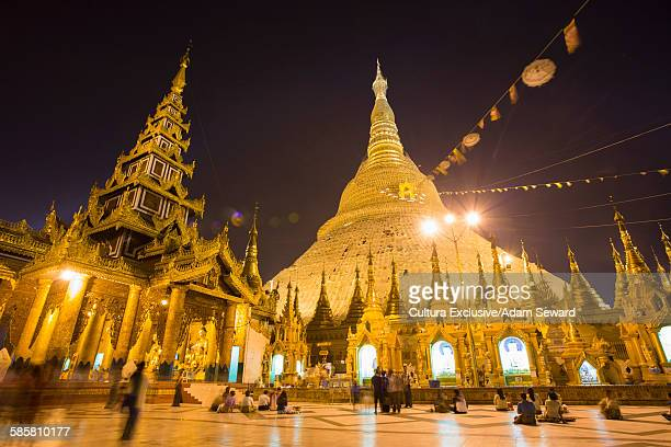 Low angle view Shwedagon Pagoda illuminated at night, Yangon, Burma