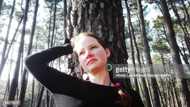 Low Angle View Woman With Hand In Hair