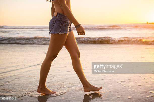 Low Angle Women Walking On The Beach