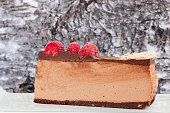 Lateral view of low carb, sugar free, homemade, no bake raspberry chocolate cheesecake slice