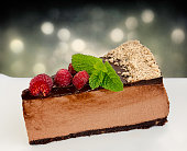 Lateral view of low carb, home made, sugar free, no bake raspberry chocolate cheesecake