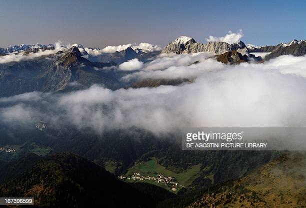Low clouds around Mount Peralba and Mount Canale view from the summit of Mount Crostis Friuli Venezia Giulia region Italy