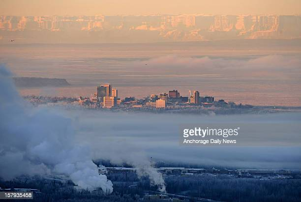 Low clouds blanket Anchorage Alaska east of downtown on Friday morning December 7 2012 An optical illusion known as Fata Morgana distorts the view of...