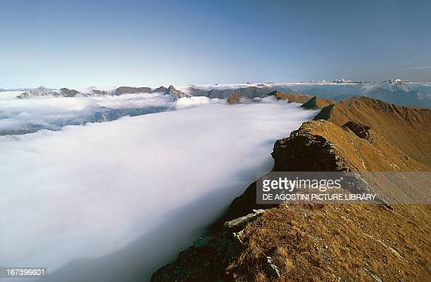 Low clouds on the east ridge that leads to the summit of Mount Crostis Friuli Venezia Giulia region Italy