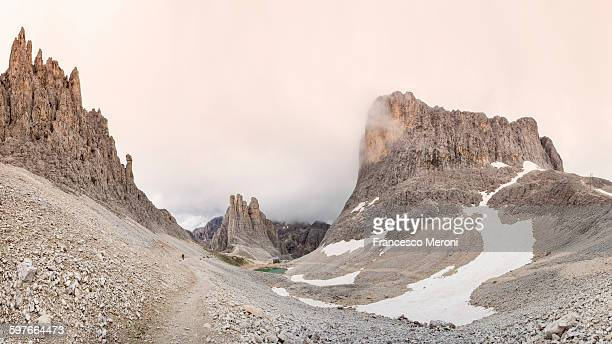Low clouds over rock formations, Dolomites, Italy