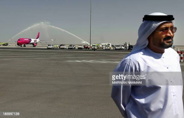 Low cost Hungarian Wizz Air airliner receives a water salute as it lands on the newly opened AlMaktoum International airport the emirate's second...