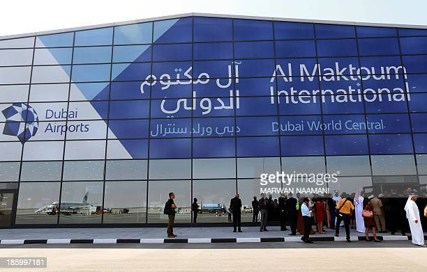 Low cost Kuwaiti alJazeera airliner is reflected in the glass of the newly opned AlMaktoum International airport the emirate's second airport in...