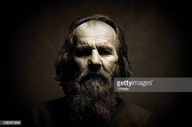 Low Ket Lit Portrait of Older Man with Long Beard