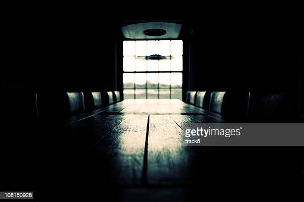 Low key empty boardroom scene; black and white