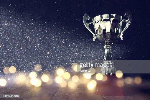low key image of trophy over wooden table : Stock Photo