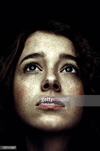 Low Key Portrait of Red Haired Woman with Freckles
