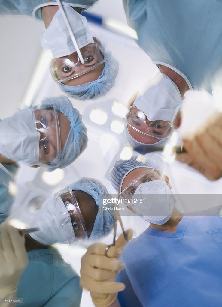 Low level view of surgical team operating : Stock Photo