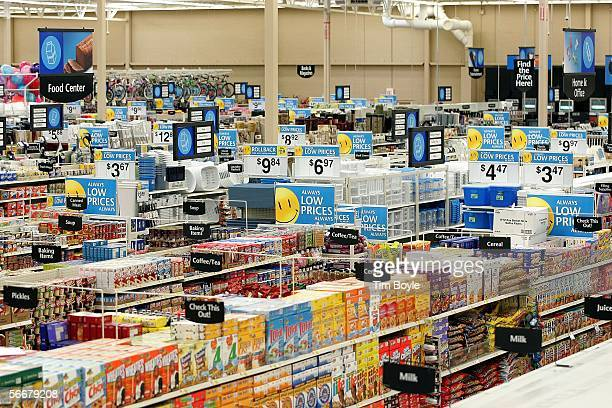 'Low Prices' signs are visible throughout several aisles in a new WalMart store January 26 2006 in Evergreen Park Illinois WalMart reportedly had at...
