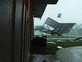 A low resolution video frame shows Hurricane Charley blowing a piece of house through the air in Port Charlotte This image provides a rare view from...