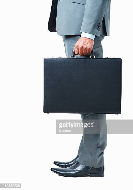 Low section of a businessman holding briefcase