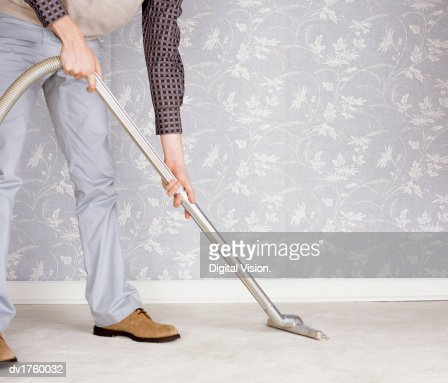 Low Section of a Man Using a Vacuum Cleaner : ストックフォト