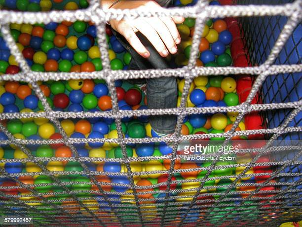 Low Section Of Child Playing In Ball Pool