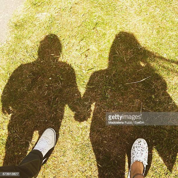 Low Section Of Couple With Shadows