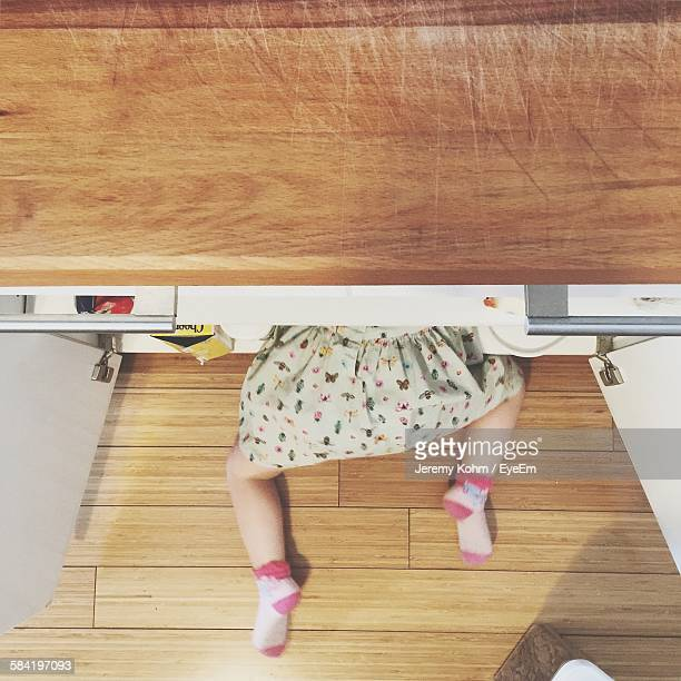 Low Section Of Girl In Cupboard