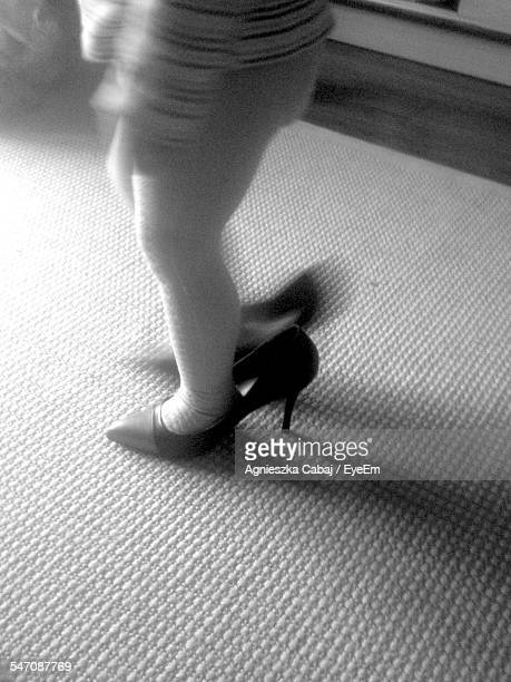 Low Section Of Girl Wearing Adult High Heels