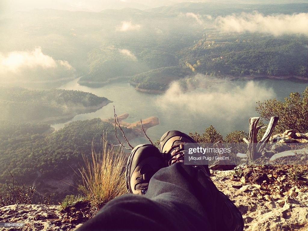 Low Section Of Hiker Resting On Cliff