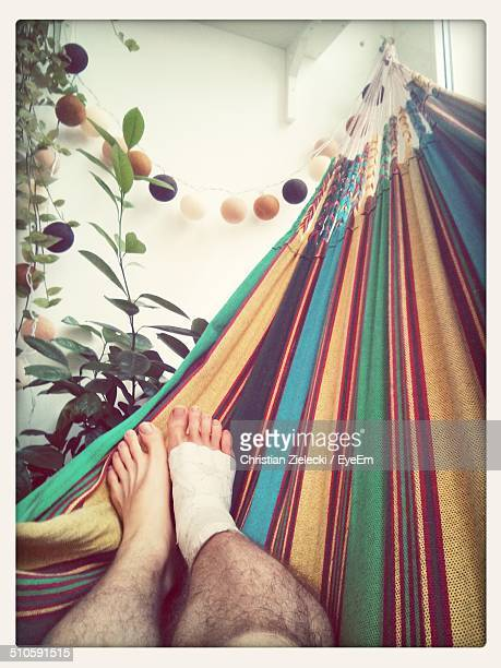 Low section of injured man on hammock