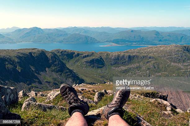 Low Section Of Man Against Mountains At Scottish Highlands