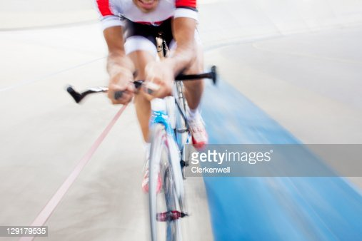 Low section of man on bicycle during competition