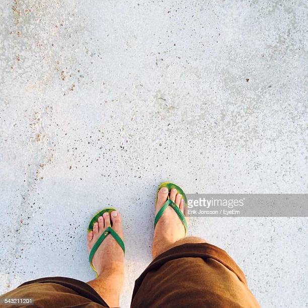 Low Section Of Man On Concrete Floor