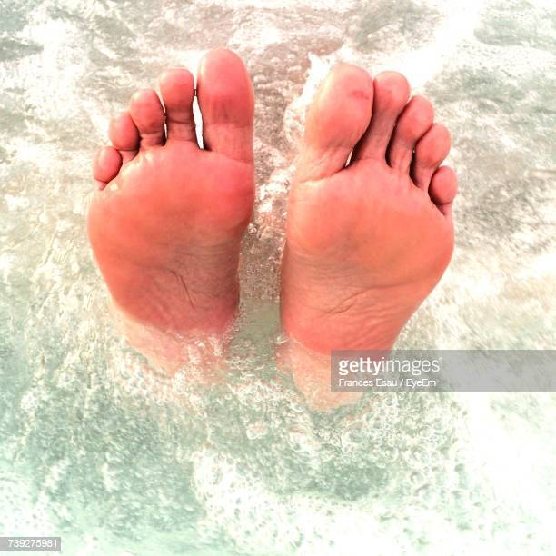 Low Section Of Man Relaxing In Water
