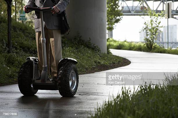 Low section of man riding segway