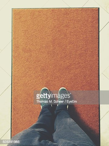Low Section of Man Standing On Floor