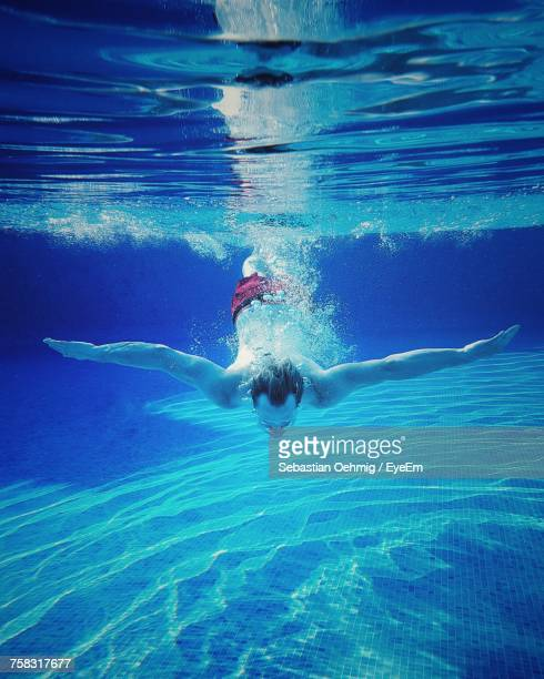 Low Section Of Man Swimming In Pool