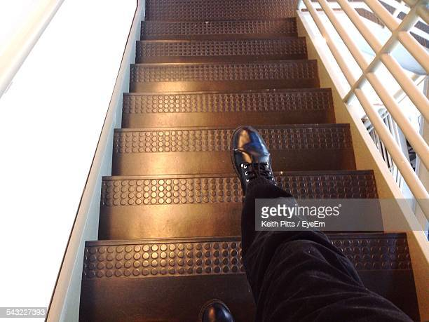Low Section Of Man Walking On Steps