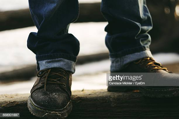 Low Section Of Man Wearing Jeans And Boots