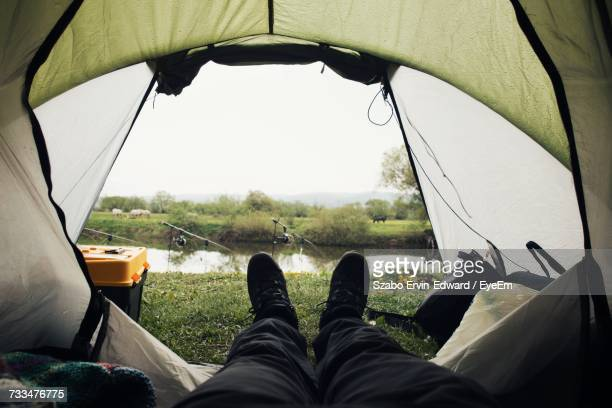Low Section Of Man Wearing Tent Against Sky