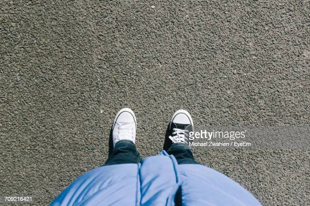 Low Section Of Man With Different Shoes