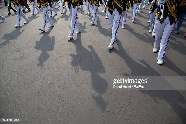 Low Section Of Marching Band On Street