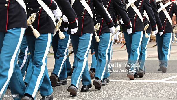 Low Section Of Military Walking On Street
