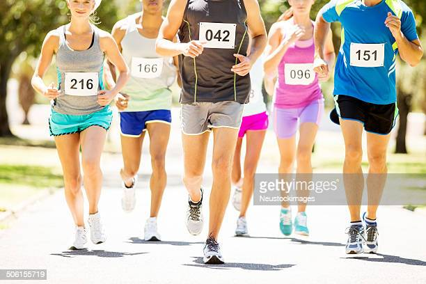 Low Section Of Multiethnic Men And Women Running Marathon