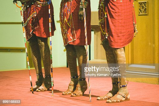 Low Section Of People In Masai Costume Performing On Stage