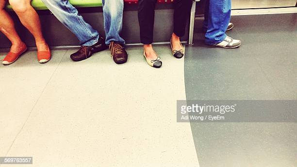Low Section Of People In Subway Train