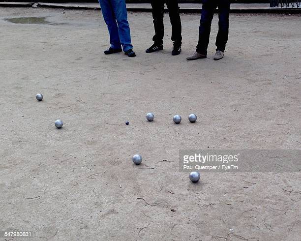 Low Section Of People Playing Petanque