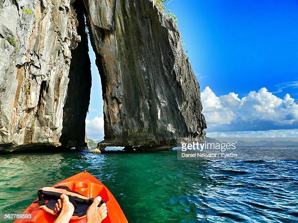 Low Section Of Person In Pedal Boat Against Sky