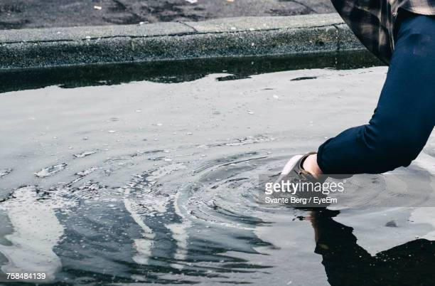Low Section Of Person In Puddle