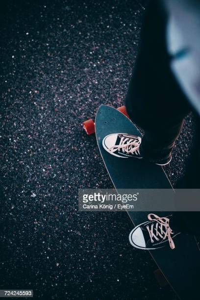 Low Section Of Person On Skateboard