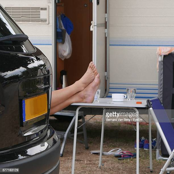 Low Section Of Person On Table Against Vehicle