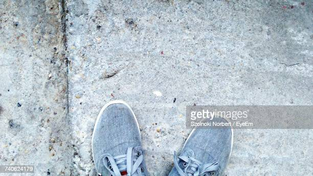 Low Section Of Person Standing On The Ground