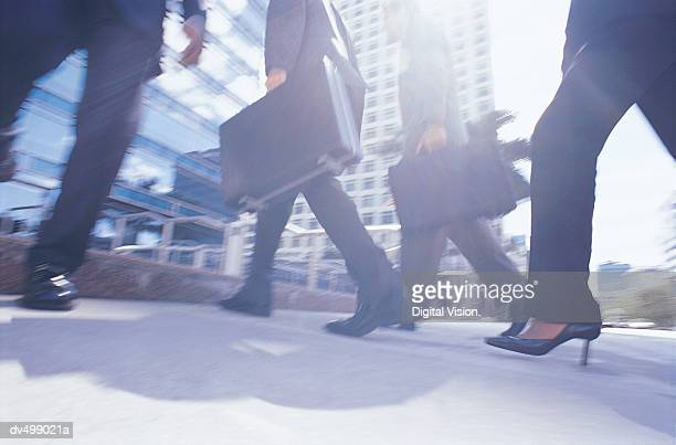 Low Section of Walking Business People